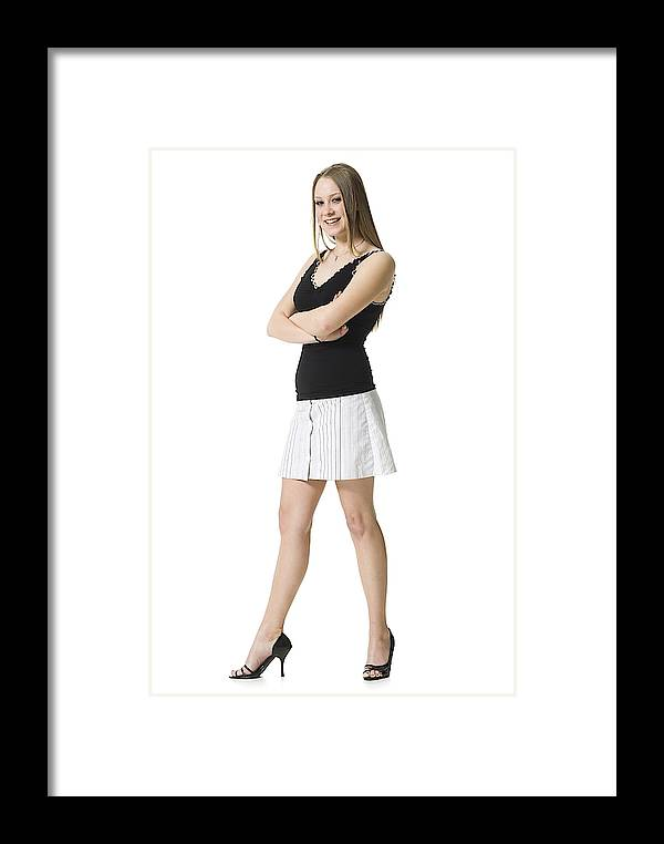Portrait Of A Teenage Girl Standing With Her Arms Crossed Framed Print