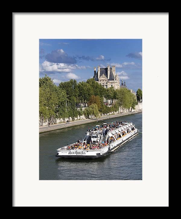 Paris Framed Print featuring the photograph Sightseeing Boat On River Seine To Louvre Museum. Paris by Bernard Jaubert