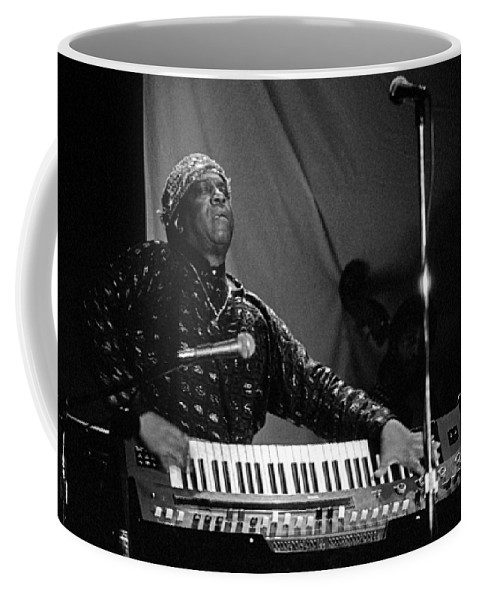 Sun Ra Coffee Mug featuring the photograph Sun Ra 1 by Lee Santa