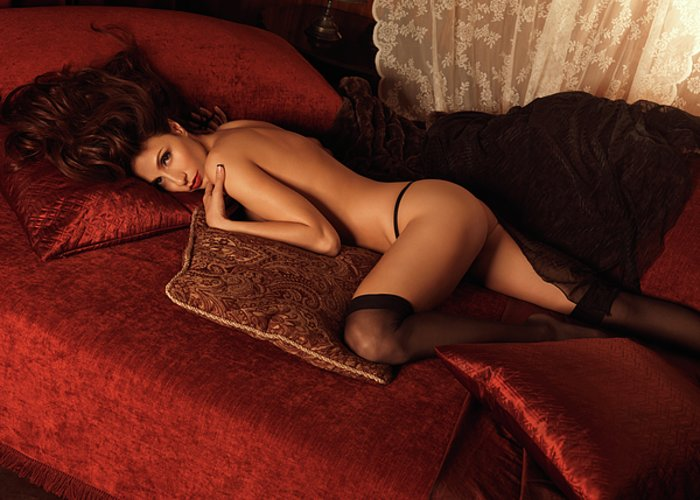 Glamour Greeting Card featuring the photograph Sexy Young Woman Lying On A Bed by Oleksiy Maksymenko