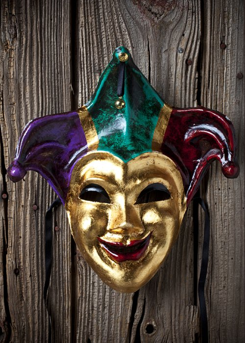 Jester Greeting Card featuring the photograph Jester Mask Hanging On Wooden Wall by Garry Gay