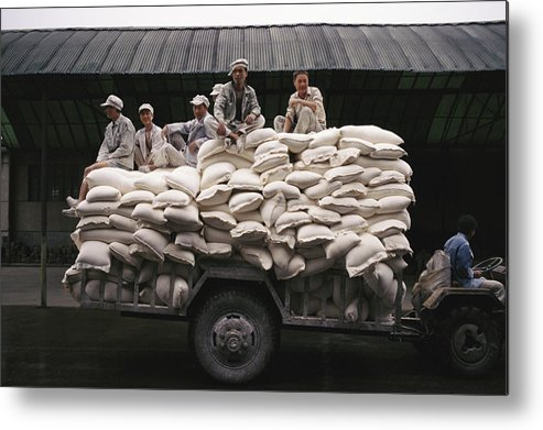Medium Group Of People Metal Print featuring the photograph Men Sit On Bags Of Flour by Justin Guariglia