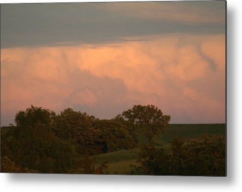 A Very Peaceful Scene Metal Print featuring the photograph Clouds Of A Distant Storm by Linda Ostby