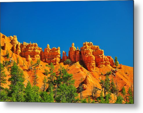 Bryce Metal Print featuring the photograph Rock Formations In Red Canyon Park In Utah. by Jay Mudaliar