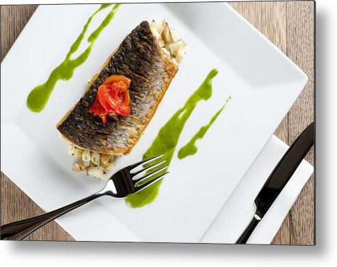 Grey Mullet Metal Print featuring the photograph Grey Mullet With Watercress Sauce Presented On A Square White Plate With Cutlery And Napkin by Andy Smy