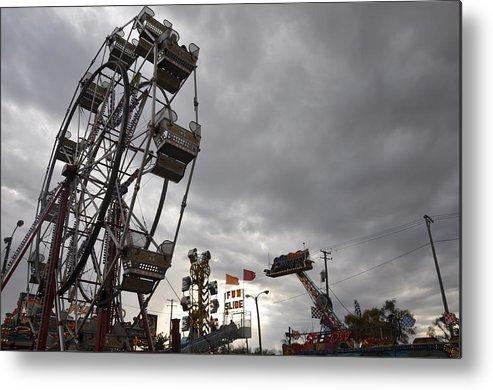 Ferris Wheel Metal Print featuring the photograph Stormy Ferris Wheel by Daniel Ness