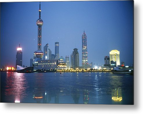 Scenes And Views Metal Print featuring the photograph The Shanghai Skyline And Riverfront by Raul Touzon