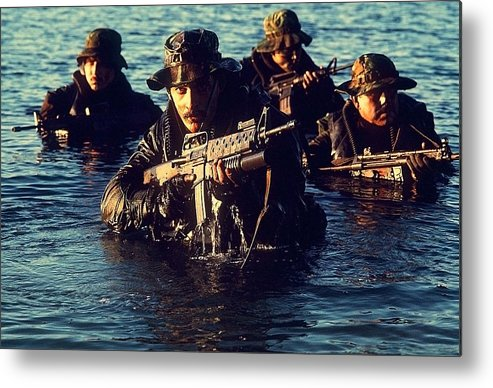 History Metal Print featuring the photograph Us Navy Seal Team Emerges From Water by Everett