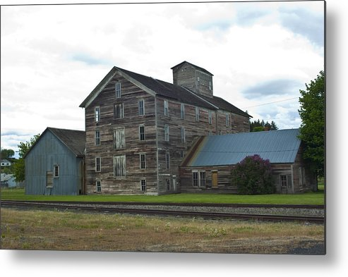 Historical Metal Print featuring the photograph Historical Barron Wheat Flour Mill In Oakesdale Wa by Louise Magno