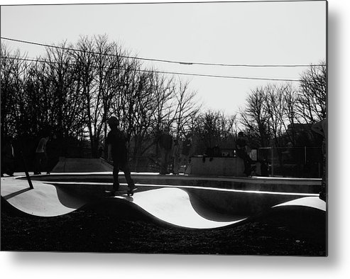 Skateboarding Metal Print featuring the photograph The Skateboarder by Margie Avellino