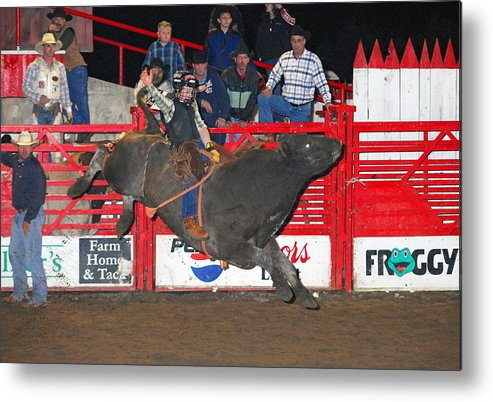 Rodeo Metal Print featuring the photograph The Bull Rider by Larry Van Valkenburgh