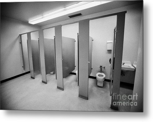 Toilet Metal Print featuring the photograph cubicle toilet stalls in womens bathroom in a High school canada north america by Joe Fox