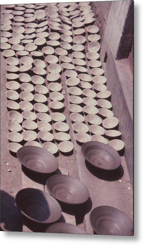 Hand-thrown Pottery Metal Print featuring the photograph Clay Yogurt Cups Drying In The Sun by David Sherman