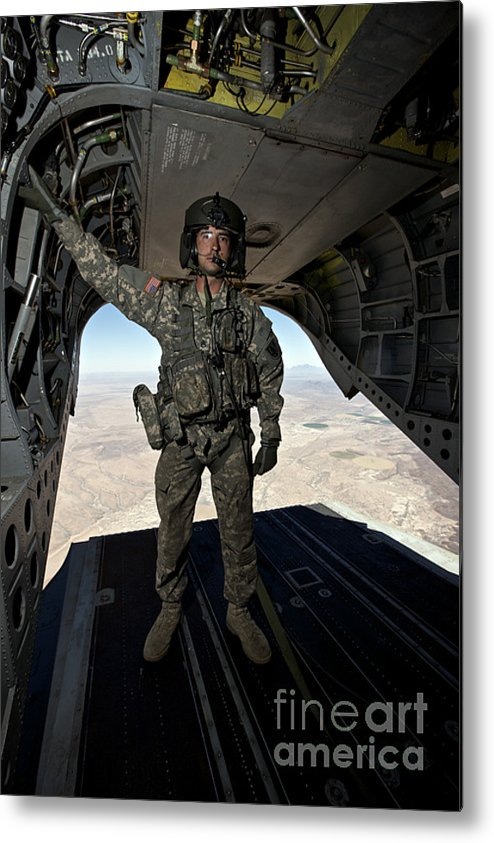 Exercise Angel Thunder Metal Print featuring the photograph Ch-47 Chinook Crew Chief Stands by Terry Moore