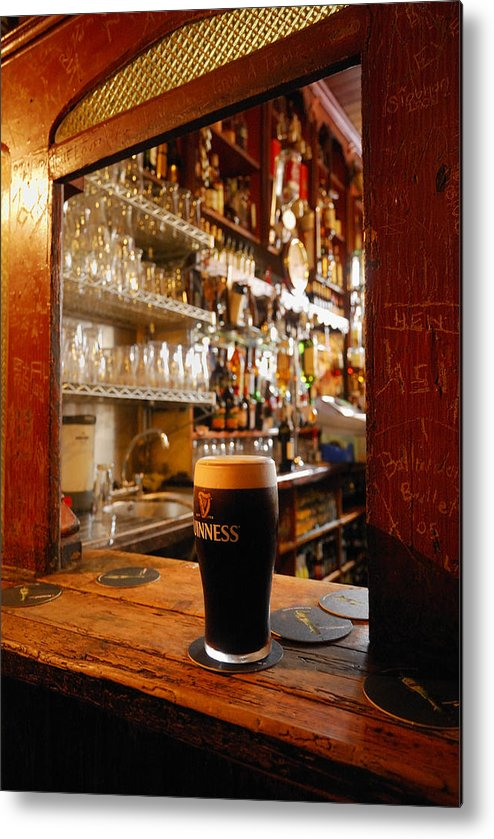 Day Metal Print featuring the photograph A Pint Of Dark Beer Sits In A Pub by Jim Richardson