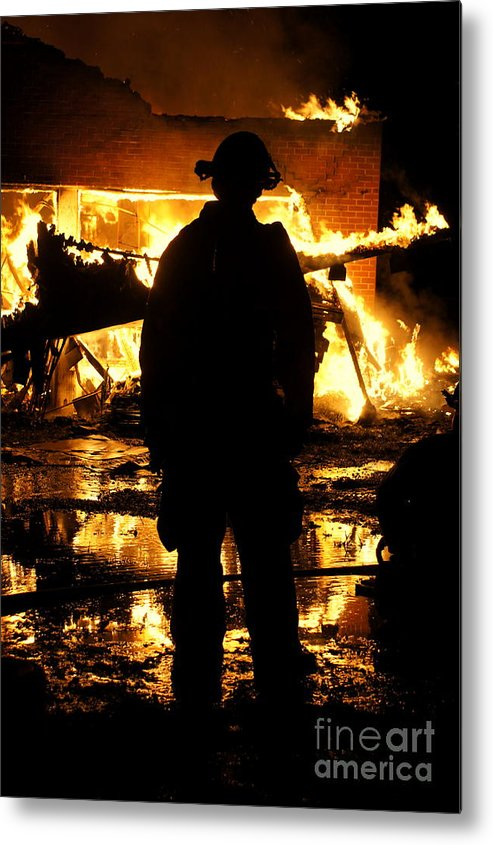 Fireman Metal Print featuring the photograph The Fireman by Benanne Stiens