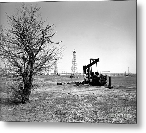 Oil Metal Print featuring the photograph Oklahoma Oil Field by Larry Keahey