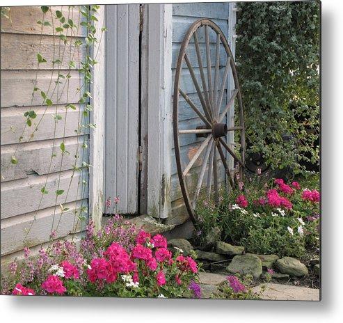 Wagon Wheel Metal Print featuring the photograph Wagon Wheel by Ann Bridges