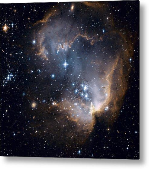 Galaxy Metal Print featuring the photograph Bright Blue Newborn Stars Blast A Hole by ESA and nASA