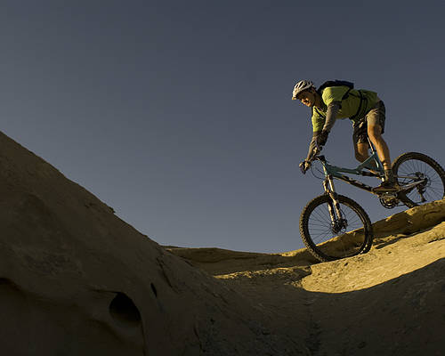 35-40 Years Poster featuring the photograph A Caucasian Man Mountain Biking by Bobby Model