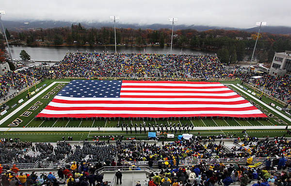 Army Poster featuring the photograph Army An American Flag Spans Michie Stadium by Associated Press