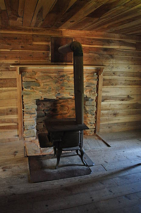 Stove Poster featuring the photograph Stove In A Cabin by Jeff Moose