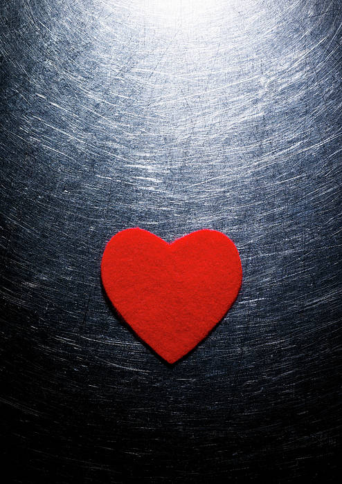 Vertical Poster featuring the photograph Red Felt Heart On Stainless Steel Background. by Ballyscanlon