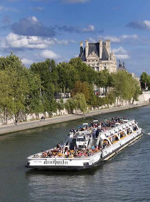 Paris Art Print featuring the photograph Sightseeing Boat On River Seine To Louvre Museum. Paris by Bernard Jaubert