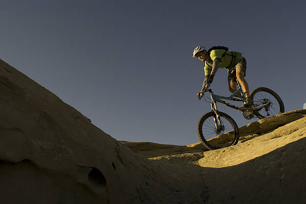 35-40 Years Art Print featuring the photograph A Caucasian Man Mountain Biking by Bobby Model