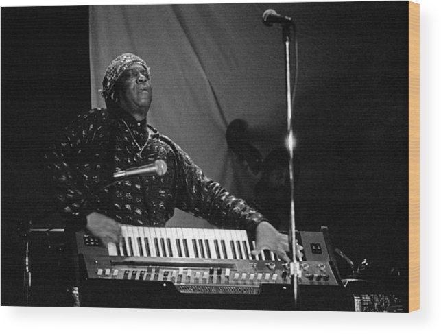 Sun Ra Wood Print featuring the photograph Sun Ra 1 by Lee Santa