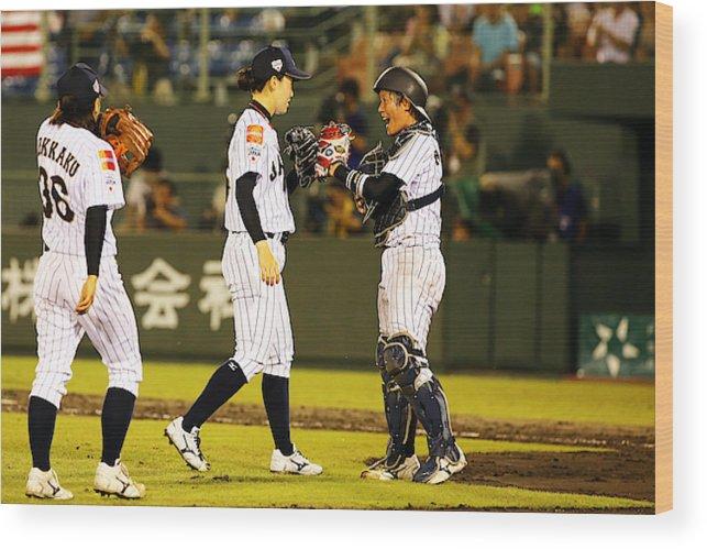 Akane Nakamura Wood Print featuring the photograph Japan V Usa - Ibaf Women s  Baseball World Cup b570bffbea