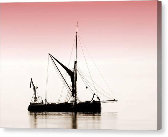 Coble Sailing  Against Pint Sky Canvas Print