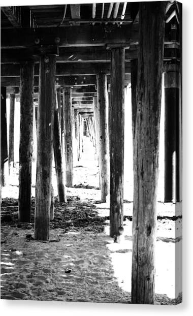 Waving Canvas Print - Under The Pier by Linda Woods