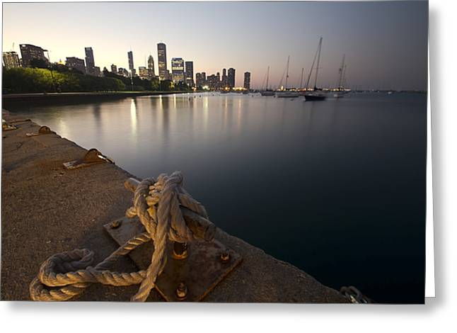 a Boat dock and Chicago skyline at dusk Greeting Card