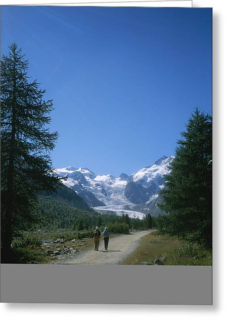 A Couple Walks Toward The Morteratsch Greeting Card by Taylor S. Kennedy