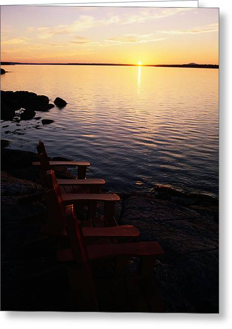 Two Empty Wooden Chairs Sit On Maines Greeting Card