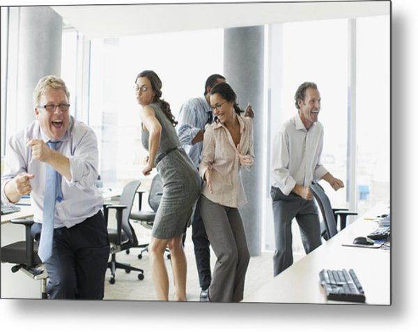 Businesspeople Dancing In Office Metal Print by Paul Bradbury