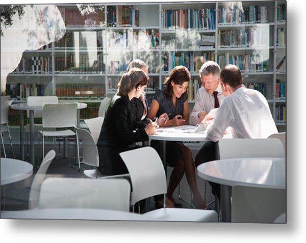 Businesspeople In Office Meeting Metal Print by Tom Merton