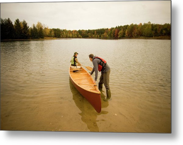 Couple Getting Ready To Paddle In Red Metal Print