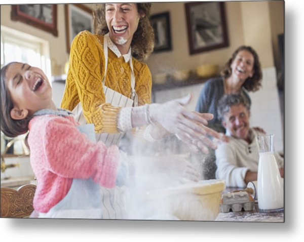 Mother And Daughter Playing With Flour In The Kitchen Metal Print by Caiaimage/Sam Edwards