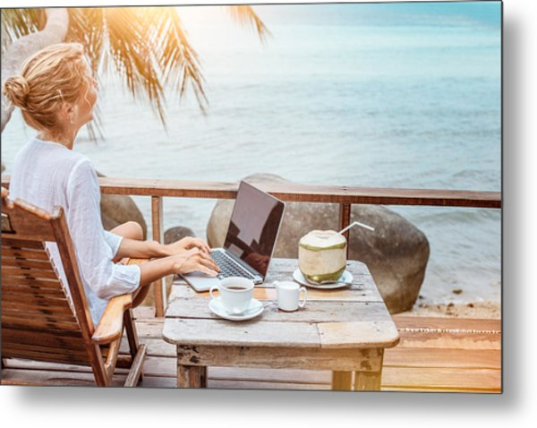 Young Woman Working On Laptop With Coffee And Young Coconut Metal Print by Jasmina007