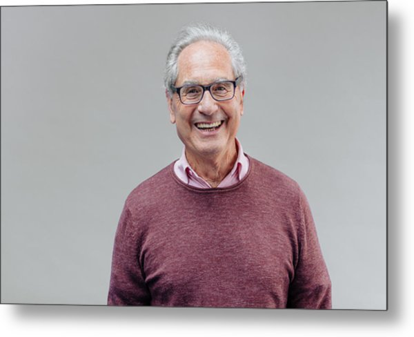 Portrait Of A Smiling Senior Business Man Metal Print by Serts