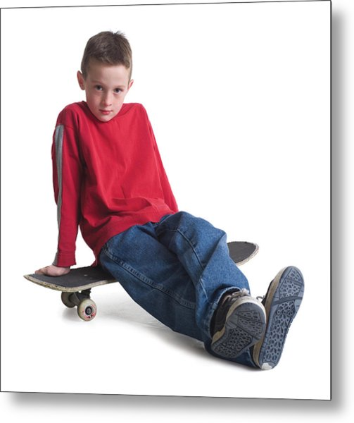 A Caucasian Boy In Jeans And A Red Sweater Sits On His Skateboard And Smiles Slightly Metal Print by Photodisc
