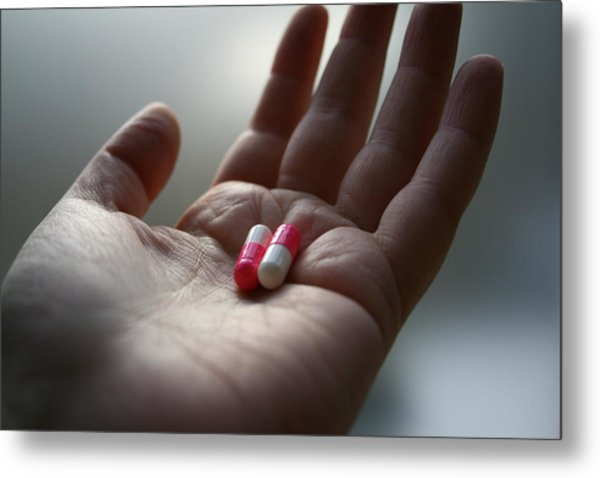 A Hand Holding Two Pills Metal Print by Red Sky