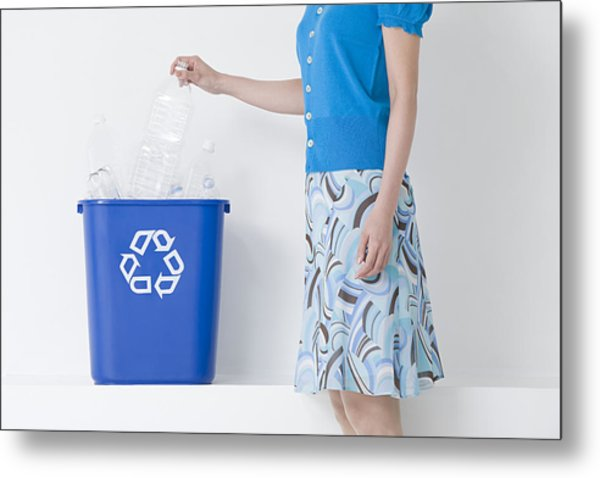 A Woman Putting A Bottle In A Recycling Bin Metal Print by Image Source
