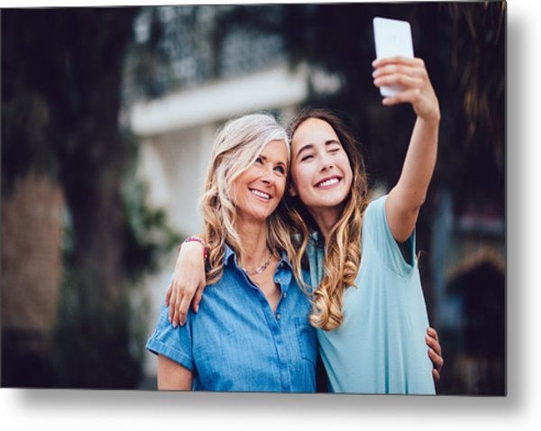Beautiful Mature Mother And Adult Daughter Taking Selfies Together Metal Print by Wundervisuals