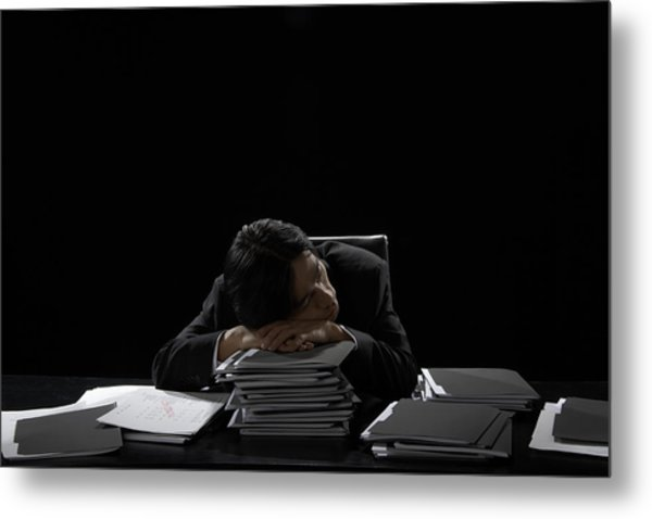 Businessman Asleep At Desk Resting Head On Stack Of Files Metal Print by James Woodson