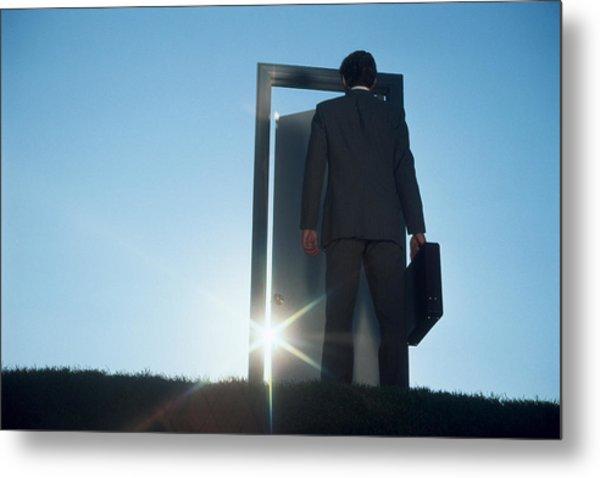 Businessman Entering Door Outdoors Metal Print by Comstock