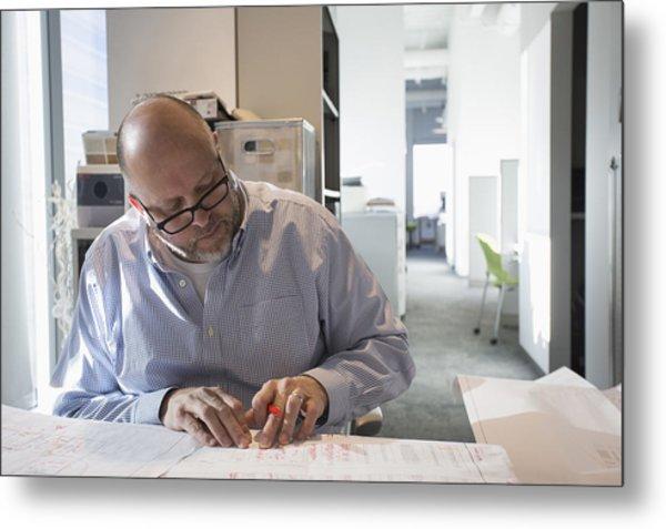 Businessman Sketching Blueprints In Office Metal Print by Hill Street Studios