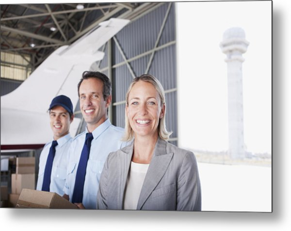 Businesswoman And Workers Standing In Hangar Metal Print by Martin Barraud